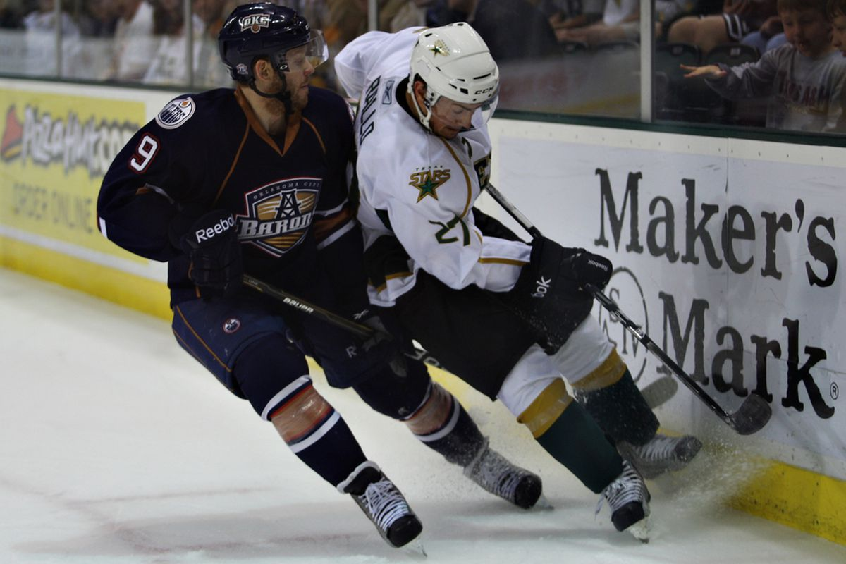 Greg Rallo battles on the board against Oklahoma City's Liam Reddox in a game on December 20th in Cedar Park. (Credit: Texas Stars)