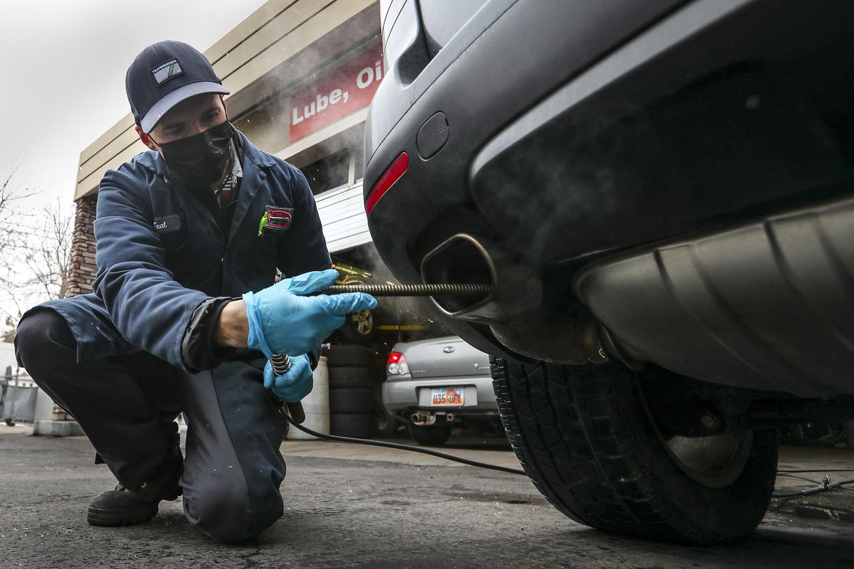 Teal Buchi performs an emission test on a vehicle at Craig's Service Center in Salt Lake City on Tuesday, Jan. 26, 2021.