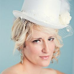 """<b>4. White Top Hat with Veil, <a href=""""https://www.etsy.com/listing/94178529/white-bridal-top-hat-white-birdcage-veil?ref=shop_home_active_1"""">$75</a></b> at Etsy. For the chic bachelorette, this white top hat with an attached veil is fashionable and a ni"""