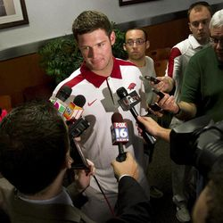 Arkansas quarterback Tyler Wilson speaks to reporters at an NCAA college football news conference in Fayetteville, Ark., Tuesday, April 24, 2012.