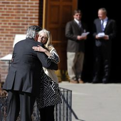 People greet as they arrive at Wasatch Presbyterian Church in Salt Lake City, Monday, March 9, 2015 for the memorial service for Deedee Corradini.