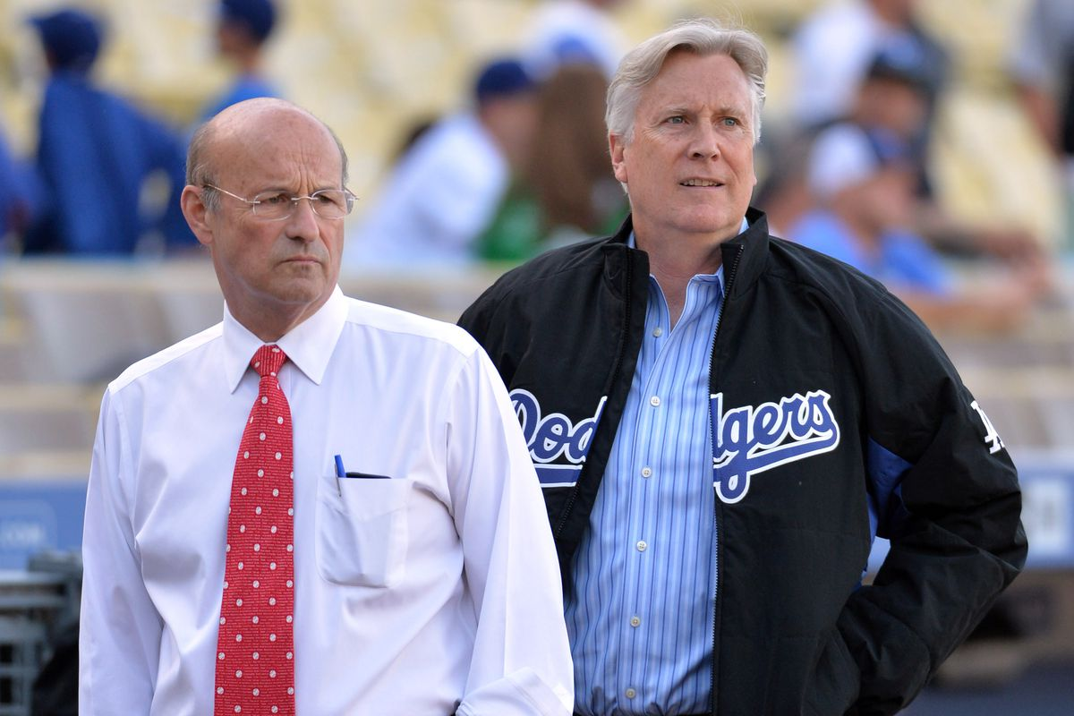 Dodgers CEO Stan Kasten and chairman Mark Walter survey the field at Dodger Stadium.