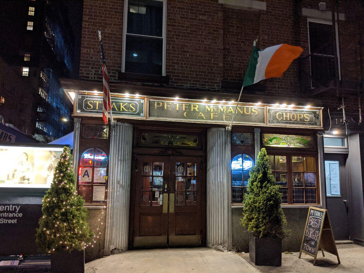 The spotlit facade of an Irish bar