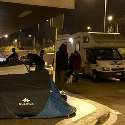 The MEDU mobile clinic, donated to the doctors' organization by the LDS Church, makes nighttime rounds to transient refugees staying on the streets in tents.