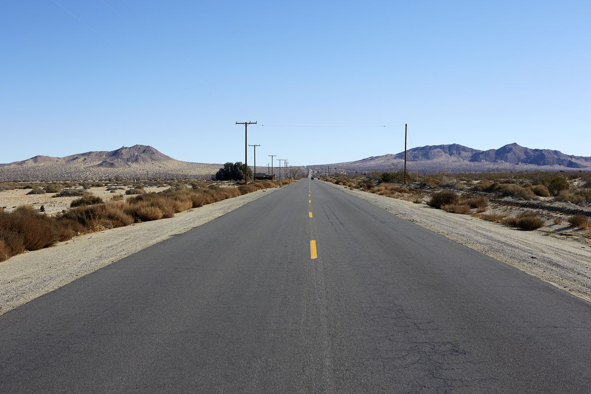 Looking down a road towards the mountains in Antelope Valley.