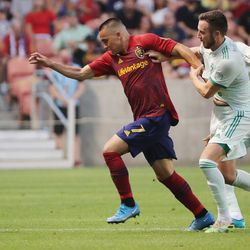 Real Salt Lake forward Bobby Wood (7) and Colorado Rapids defender Danny Wilson (4) compete for the ball at Rio Tinto Stadium in Sandy on Saturday, July 24, 2021.