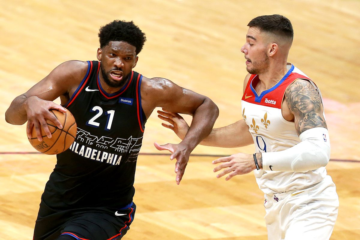 Joel Embiid of the Philadelphia 76ers is defended by Willy Hernangomez of the New Orleans Pelicans during the second quarter of an NBA game at Smoothie King Center on April 09, 2021 in New Orleans, Louisiana.