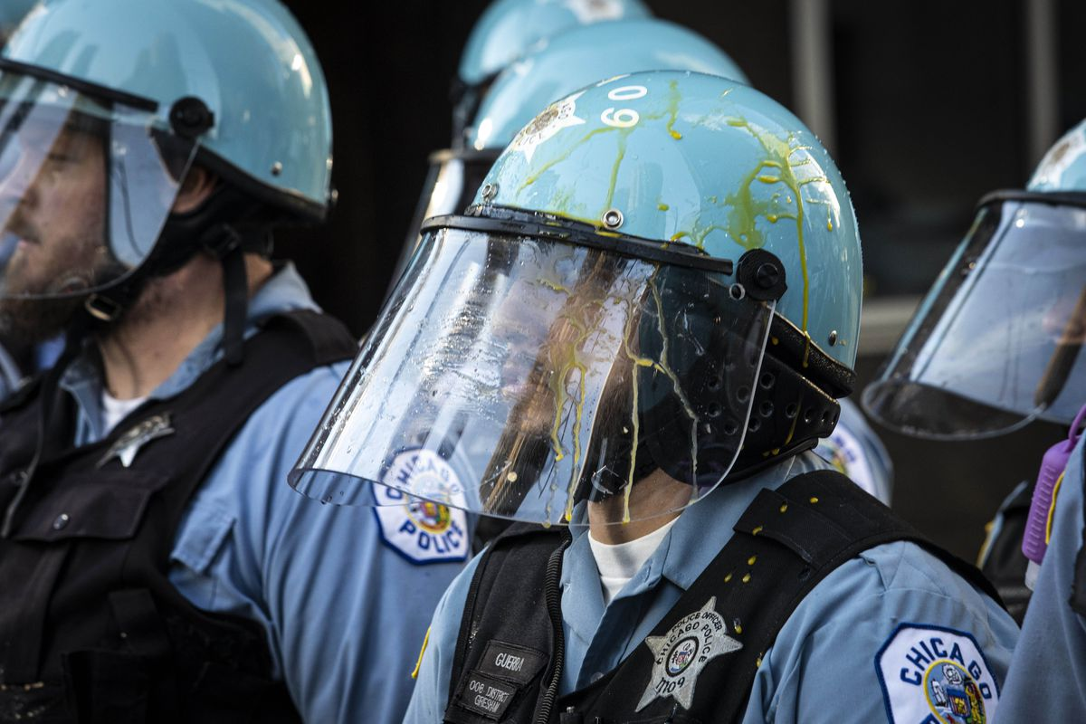 A Chicago police officer has egg on his face shield as thousands of protesters in the city join national outrage over the killing of George Floyd in Minneapolis police custody, Saturday afternoon, May 30, 2020.