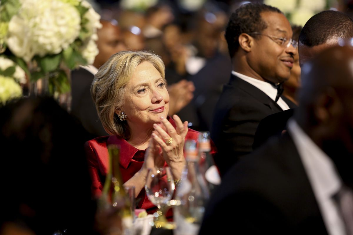 Democratic presidential candidate Hillary Rodham Clinton applauses a speaker at the Congressional Black Caucus Foundations 45th Annual Legislative Conference Phoenix Awards Dinner at the Walter E. Washington Convention Center on September 19, 2015.