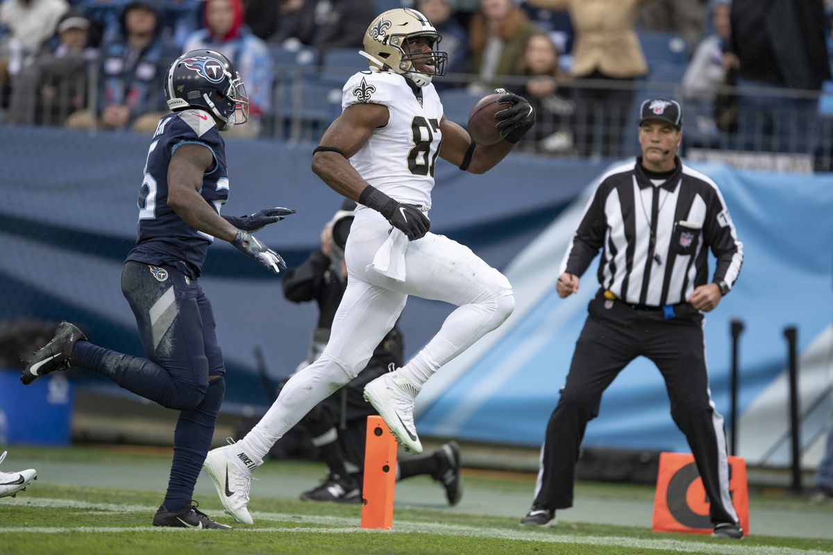 Jared Cook of the New Orleans Saints scores a touchdown during the first half of a game against the Tennessee Titans at Nissan Stadium on December 22, 2019 in Nashville, Tennessee.