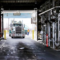 One of two transport trucks pulls into an open bay so it can be filled with Tier 3 fuel at the HollyFrontier refinery in Woods Cross on Friday, Dec. 11, 2020. Earlier, Gov. Gary Herbert, Mike Jennings, HollyFrontier president and CEO, and Scott White, vice presidentand refinery manager, held a ribbon-cutting ceremony to celebrate the completion of the refinery's effort to bring cleaner burning Tier 3 fuels to market along the Wasatch Front.