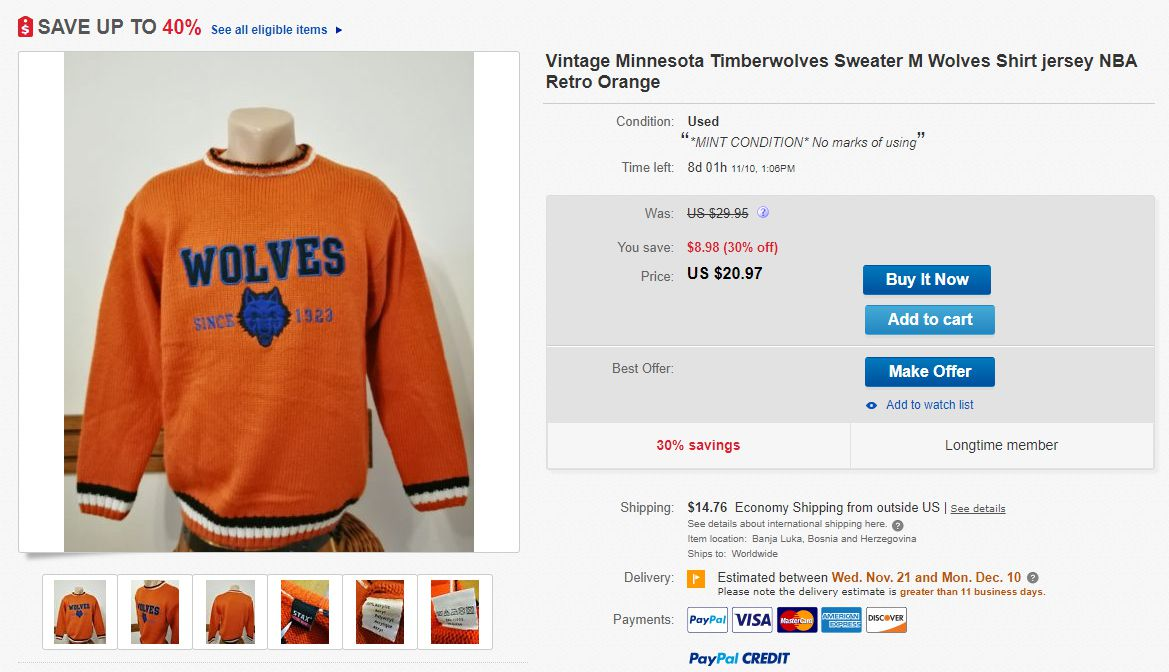 """An ugly orange and blue sweater listed for sale on eBay. The listing calls it a Timberwolves NBA sweater but the sweater has a blue wolf head, just says """"WOLVES"""" and also says established in 1923."""