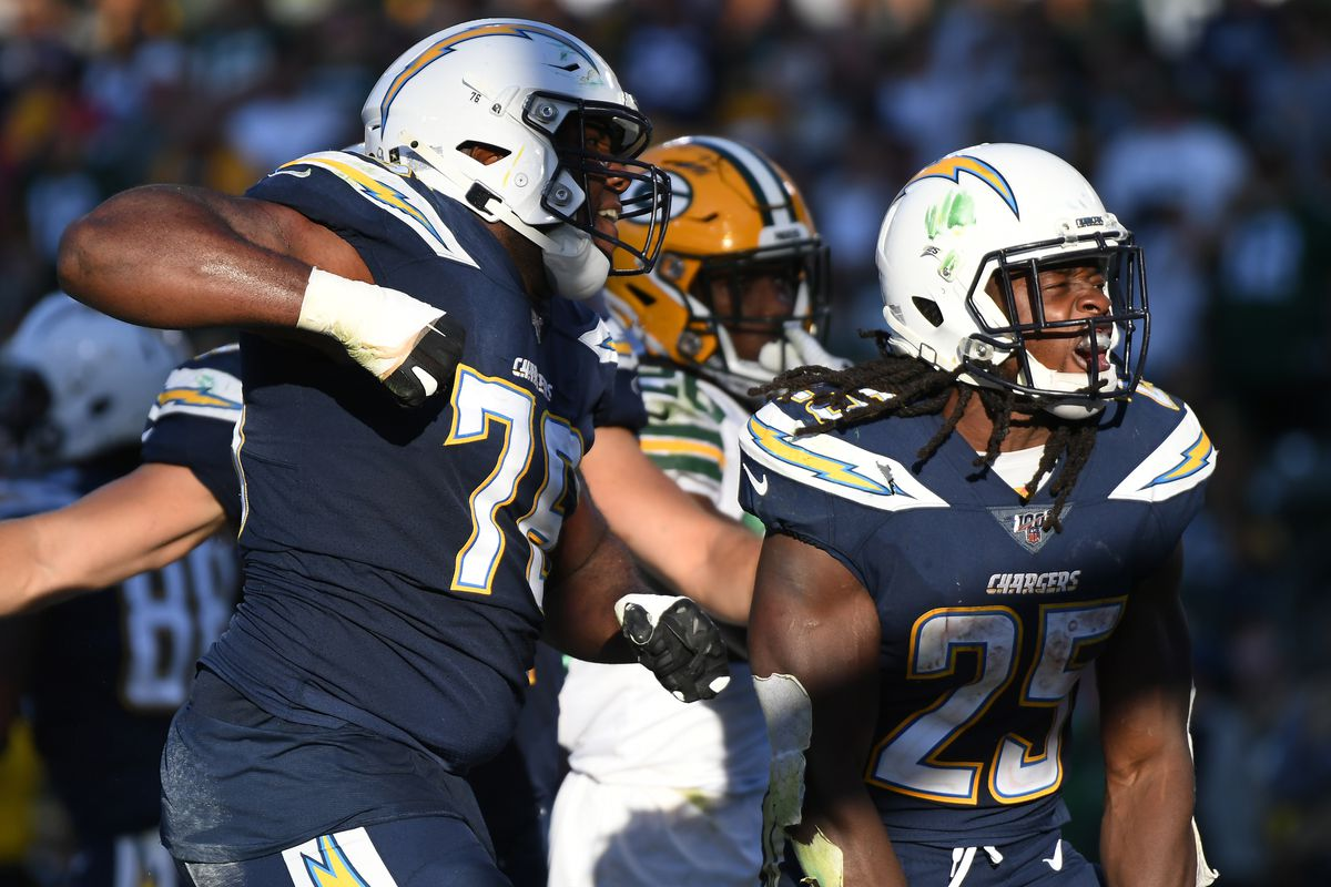 Los Angeles Chargers running back Melvin Gordon celebrates with offensive tackle Russell Okung after scoring on a one yard touchdown run against the Green Bay Packers during the fourth quarter at Dignity Health Sports Park.