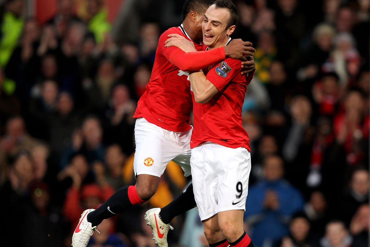 Patrice Evra and Dimitar Berbatov did not travel with Manchester United to Amsterdam