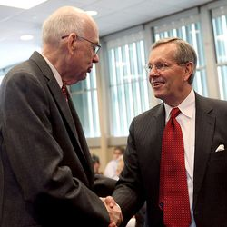 Former Sen. Robert Bennett speaks with former Utah Governor Mike Leavitt at his induction ceremony into the into the Hinckley Institute Hall of Fame at the University of Utah in Salt Lake City on Wednesday, Jan. 27, 2016.