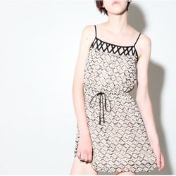 """a.ok Sleeveless Printed Dress, $37 at <a href=""""http://www.oaknyc.com/aok-taupe-sleeveless-printed-dress.html?enlarged"""">Oak</a>: To look a little less naked, pair it with tights. Unless, of course, that's what you were going for."""
