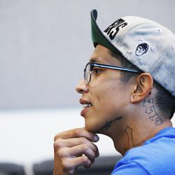Gabe, a homeless youth, talks with Salt Lake attorney Nicole Lowe at Volunteers of America's Youth Resource Center in Salt Lake City on Thursday, Sept. 15, 2016.