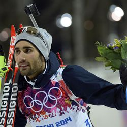 Martin Fourcade (FRA) reacts after winning gold in the men's 20km individual biathlon