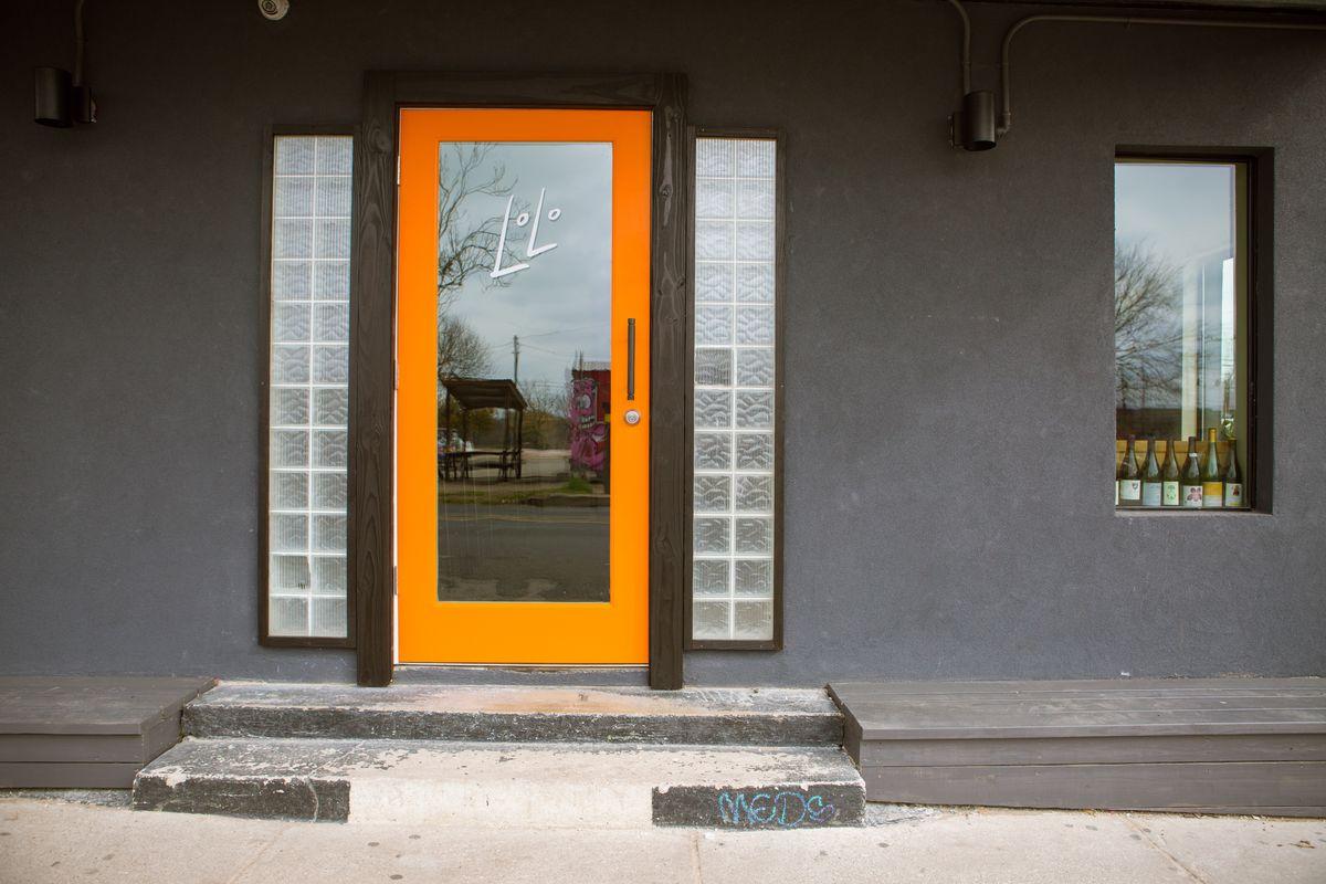 Lolo wine bar's exterior with an orange trim door