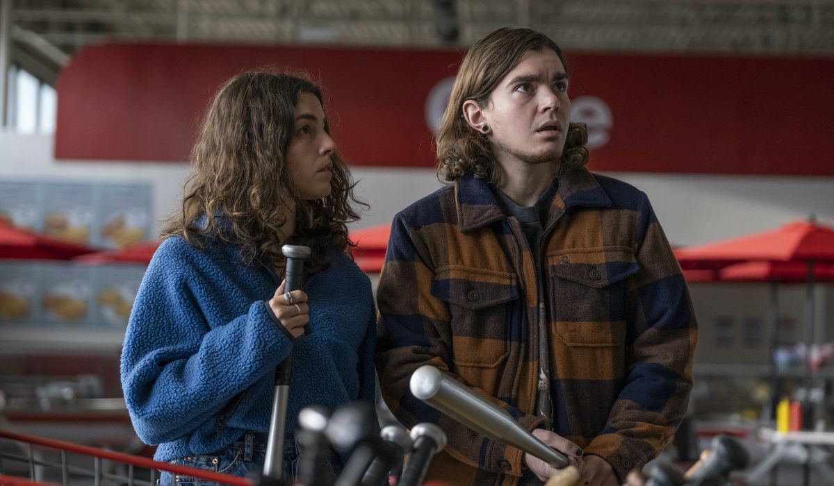 Elliot Fletcher as Sam and Olivia Thirlby as the hero cling to baseball bats as they prepare for a possible attack on a large store in Y: The Last Man