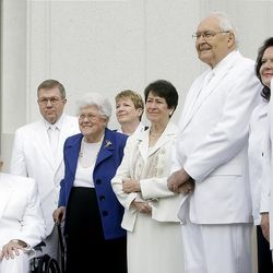 Elder Packer, left, is joined by Elders Perry, center right, and Elder Nelson and their wives and others from the temple department for the cornerstone ceremony at the Brigham City Temple prior to the dedication Sunday, Sept. 23, 2012.