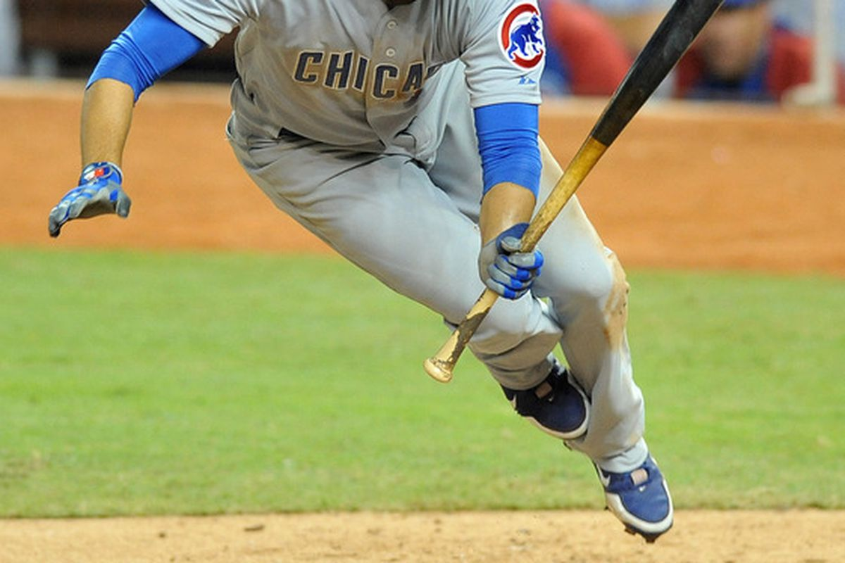 Miami, FL, USA; Chicago Cubs right fielder David DeJesus is hit by a pitch by Miami Marlins relief pitcher Steve Cishek in the eighth inning at Marlins Park. Mandatory Credit: Steve Mitchell-US PRESSWIRE
