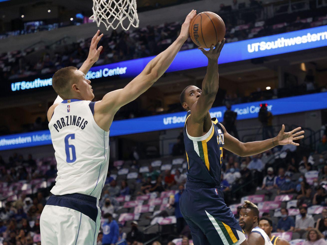 Dallas Mavericks forward Kristaps Porzingis (6) blocks a shot attempt by Utah Jazz's Malik Fitts.