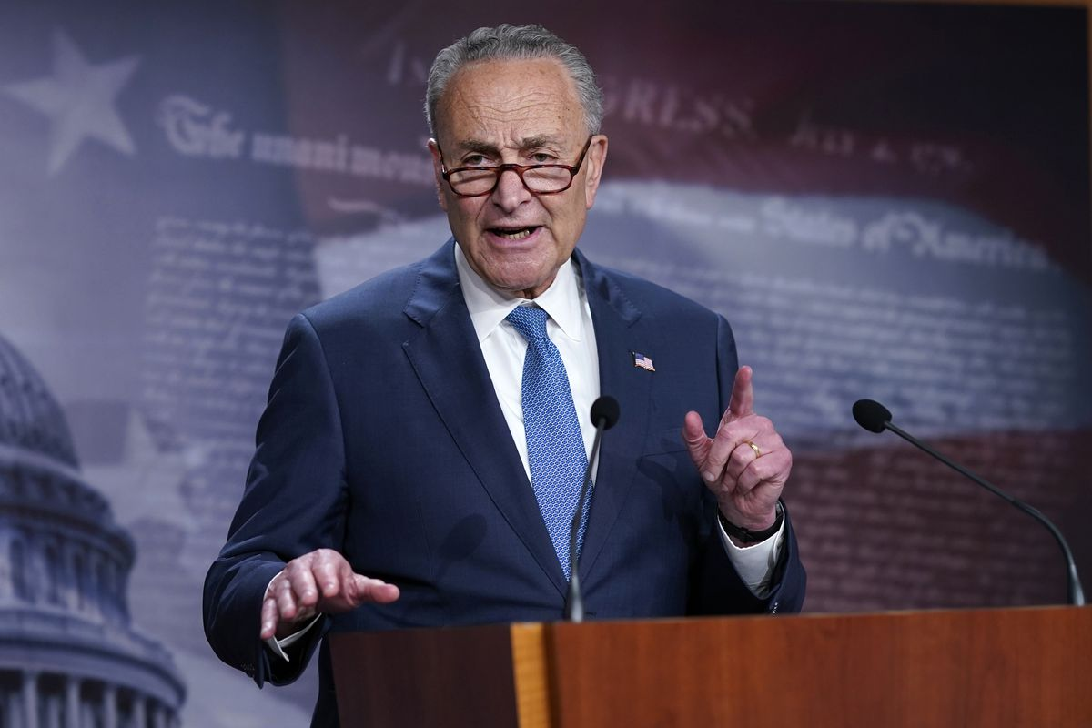 """Senate Majority Leader Chuck Schumer, D-N.Y., speaks to reporters at the Capitol in Washington. Schumer warned his Democratic colleagues that June will """"test our resolve"""" as senators return Monday to consider infrastructure, voting rights and other priorities. Six months into Democrats' hold on Washington, the senators are under enormous pressure to make gains on Democrats' campaign promises."""