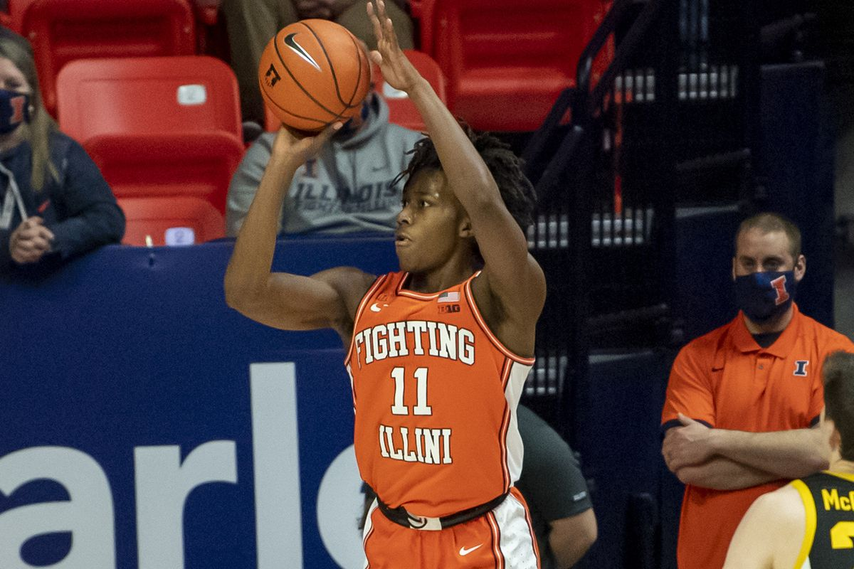 Illinois Fighting Illini guard Ayo Dosunmu makes a three point basket against the Iowa Hawkeyes during the second half at the State Farm Center.