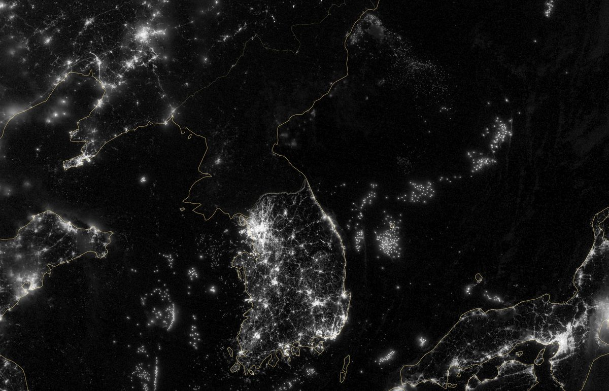 North korea defends blackout satellite photos the essence of north korea night satellite nasa gumiabroncs Image collections