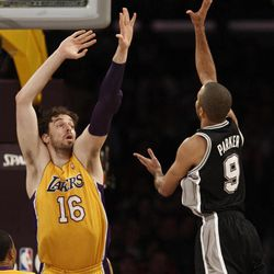 San Antonio Spurs guard Tony Parker (9), of France, shoots as Los Angeles Lakers' Pau Gasol (16) of Spain defends during the first half of their NBA basketball game, Tuesday, April 17, 2012, in Los Angeles.