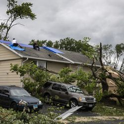 Homes are severely damaged on Chestnut Avenue near Evergreen Lane in Woodridge after a tornado ripped through the western suburbs overnight, Monday morning, June 21, 2021.