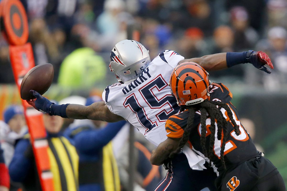 New England Patriots wide receiver N'Keal Harry (15) dives for the pass as Cincinnati Bengals cornerback B.W. Webb defends during the fourth quarter at Paul Brown Stadium.