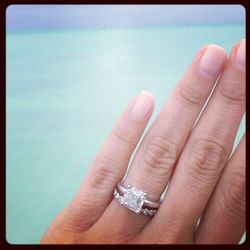 """""""I love that my husband picked out my ring without asking me what I wanted. It is exactly what I would have picked so he knows me pretty well. It is an asscher-cut diamond on a simple band. I love layering rings so will keep stacking them up. I was so sur"""