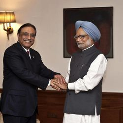 Pakistan President Asif Ali Zardari, left, shakes hands with Indian Prime Minister Manmohan Singh prior to their meeting at the latter's residence in New Delhi, India, Sunday, April 8, 2012. Zardari arrived in India on a private trip Sunday that also gives him a chance to meet Indian leaders amid a thaw in relations between the two South Asian rivals.