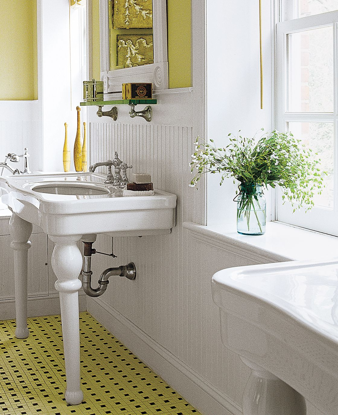 White wainscoting on bathroom walls.