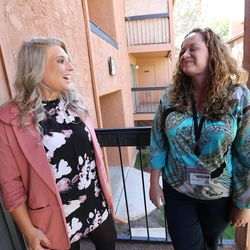 Intensive Supervision client Crissy Elmer, left, talks with Jeannie Ybarra, right, of Salt Lake County Criminal Justice Services in Salt Lake City on Thursday, Oct. 6, 2016.