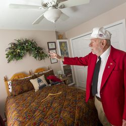 """Longtime track starter Gerard """"Jerry"""" Collet points out special memories as he reminisces at his South Jordan home on Tuesday, April 28, 2020, about all the different places around the country that he has been an official."""