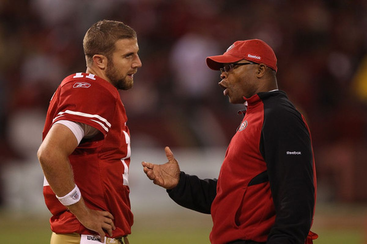 Head coach Mike Singletary of the San Francisco 49ers talks with quarterback Alex Smith. Is he speaking in tongues?