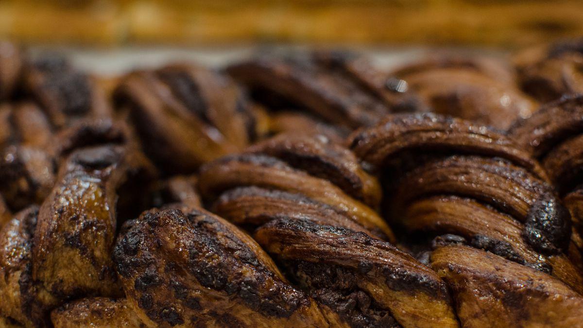 Close shot of a bumpy, shiny loaf of chocolate babka
