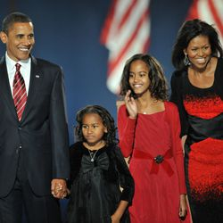 Barack Obama and his family arrive on stage for his election night victory rally at Grant Park. | Emmanuel Dunand/AFP/Getty Images