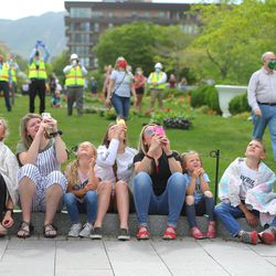 Onlookers gather to watch as the Angel Moroni statue is lowered to the ground by workers from Jacobsen Construction as they remove it from the Salt Lake Temple of The Church of Jesus Christ of Latter-day Saints in Salt Lake City on Monday, May 18, 2020.