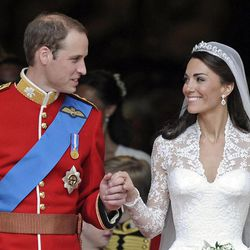 FILE - In this April 29, 2011 file photo, Britain's Prince William and his wife Kate, Duchess of Cambridge stand outside of Westminster Abbey after their Royal Wedding in London. The couple celebrate their first anniversary on Sunday.