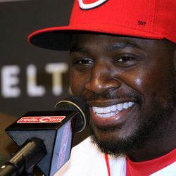 Cincinnati Reds Brandon Phillips smiles as he talks with the media after the announcement  of  his signing of a six year contract at Great American Ballpark in Cincinnati Tuesday April 10, 2012. Phillips signed  a six-year, $72.5 million contract through the 2017 season.