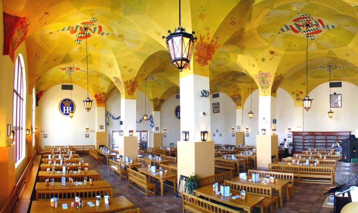 A German-inspired dining room with yellow walls and high ceilings.