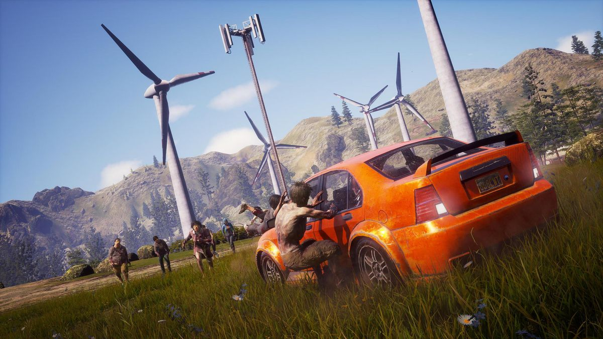 State of Decay 2 - a player's sports car is mobbed by zombies in a grassy field with wind turbines in the distance.