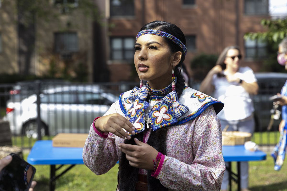 Maritza Garcia, who beaded and sew her traditional dress herself, said the holiday should've been changed a long time ago. Garcia talks about background at Pottawattomie Park at 7340 N. Rogers Ave in Rogers Park to protest after Cook County Commissioners refused to advance a measure replacing Columbus Day with Indigenous Peoples' Day, Monday, Oct. 11, 2021.   Anthony Vazquez/Sun-Times