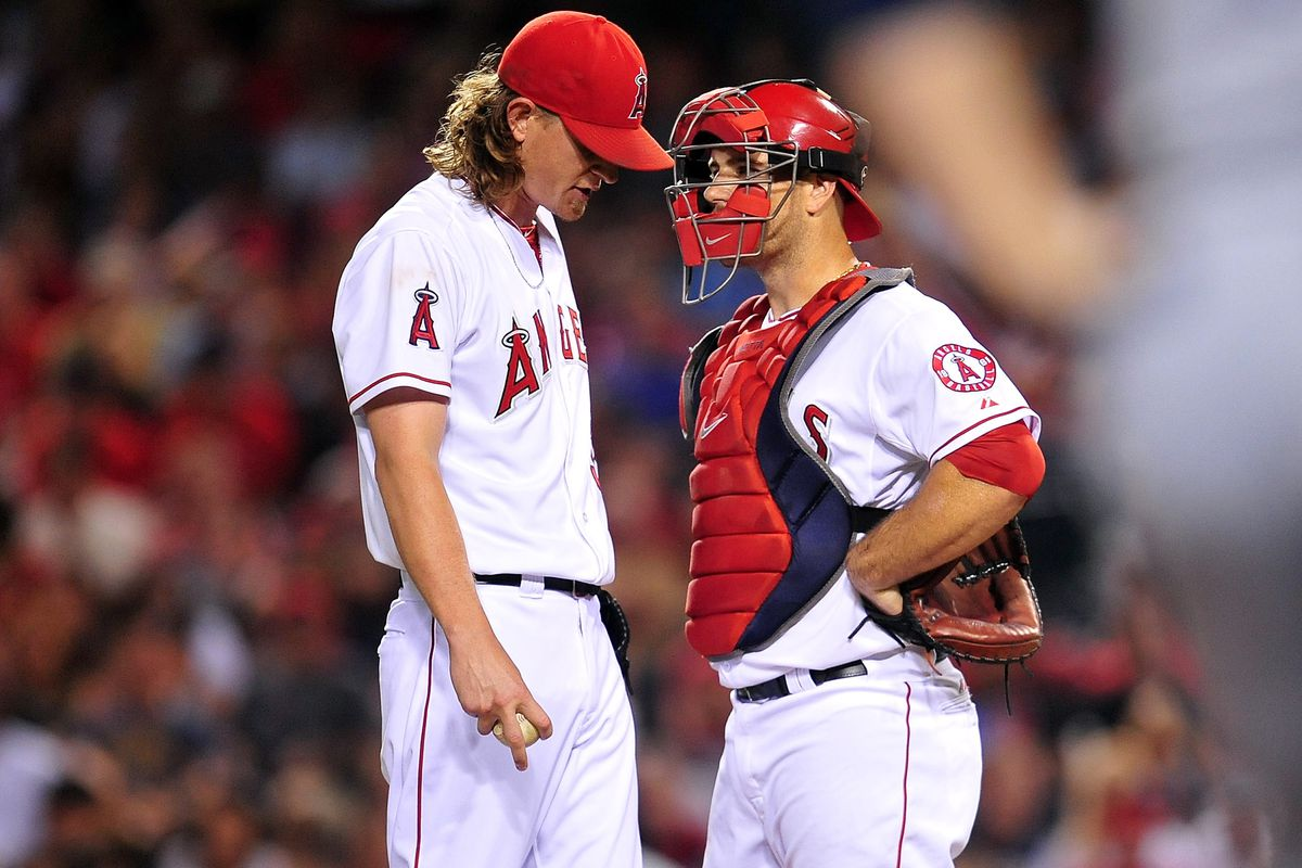 August 17, 2012; Anaheim, CA, USA; Los Angeles Angels starting pitcher Jered Weaver (36) speaks with catcher Chris Iannetta (17) during the fourth inning against the Tampa Bay Rays at Angel Stadium. Mandatory Credit: Gary A. Vasquez-US PRESSWIRE