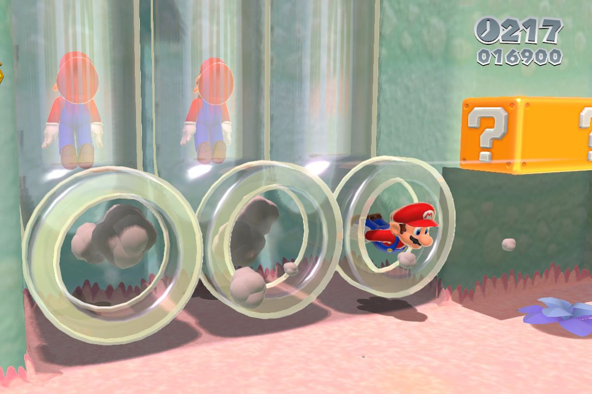 Marios move through clear pipes in a screenshot from Super Mario 3D World
