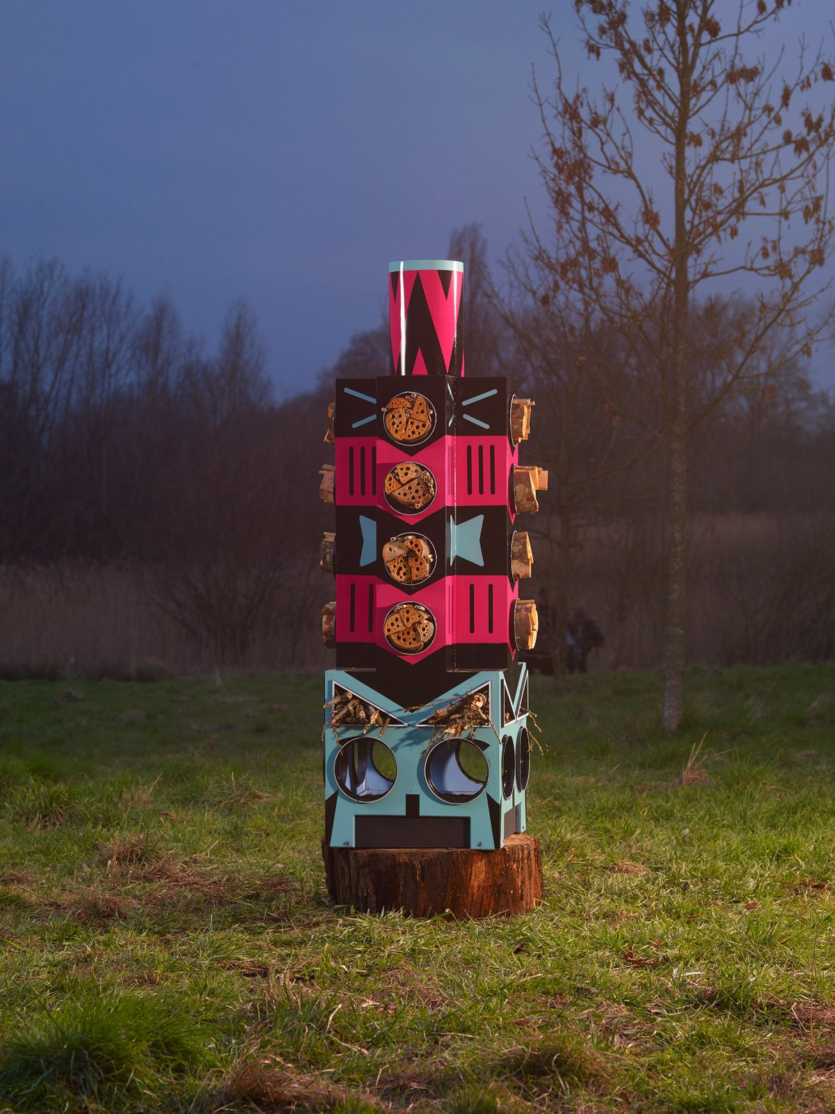 A colorful wildlife house designed to resemble a totem stack.